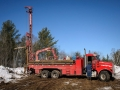 Well drillers set up the drill rig.