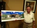 Ishwar holds architectural view of Conference Center.