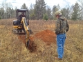 Digging trenches for soil tests.